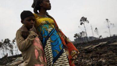 Photo of CHILDREN FLEE FROM THE VOLCANO IN RWANDA